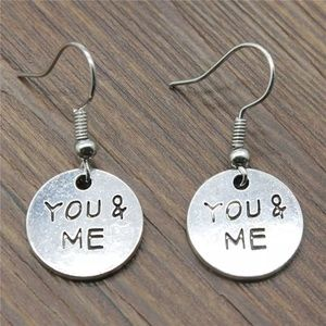 silver color you and me earrings